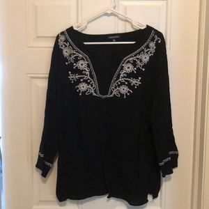 Gauze embellished top. Black with white accents.